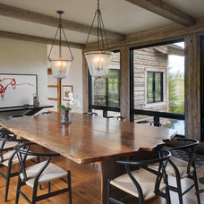 Rustic Dining Room by Snake River Interiors