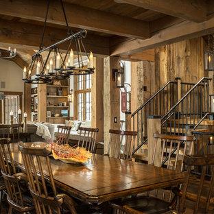 Example Of A Mountain Style Dark Wood Floor And Brown Floor Dining Room  Design In Burlington
