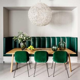 Пример оригинального дизайна: столовая среднего размера в стиле модернизм с серыми стенами и серым полом