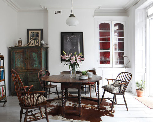 This is an example of a traditional dining room in London with white walls   painted. Traditional Dining Room Design Ideas  Renovations   Photos