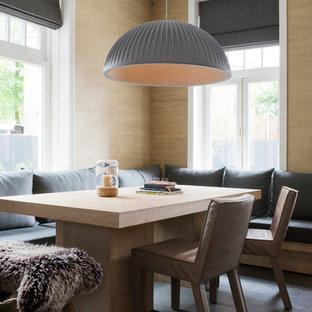 Imagen de comedor escandinavo con paredes marrones