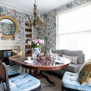 Immagine di una sala da pranzo aperta verso il soggiorno chic di medie dimensioni con pareti multicolore, parquet scuro, camino classico, cornice del camino piastrellata e pavimento marrone