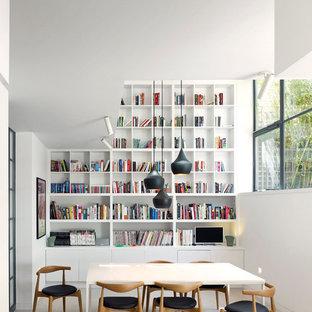 Immagine di una sala da pranzo scandinava con pareti bianche