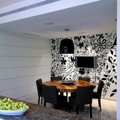 Trendy medium tone wood floor kitchen/dining room combo photo in Other
