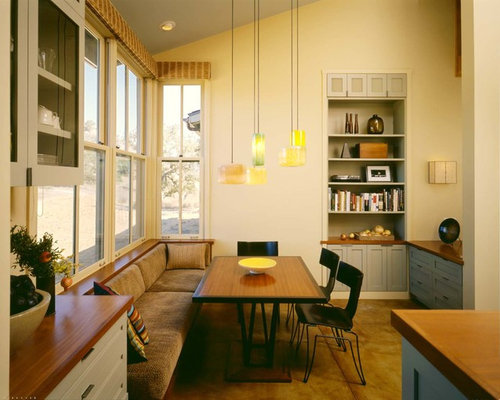 Example Of A Trendy Concrete Floor Dining Room Design In San Francisco