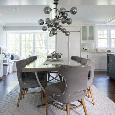 Example of a mid-sized transitional dark wood floor and brown floor great room design in DC Metro with gray walls and no fireplace