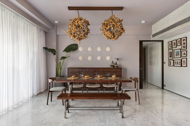 Contemporary Dining Room by amritha karnakar architectural design