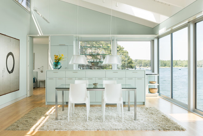 Beach Style Dining Room by Elliott + Elliott Architecture