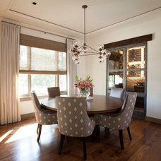 Traditional Dining Room by Laura U, Inc.