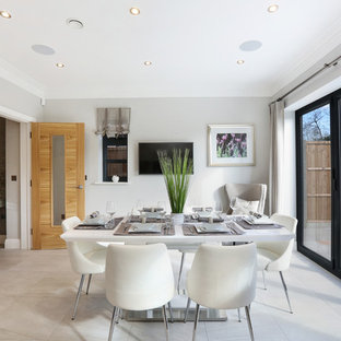 Inspiration for a medium sized contemporary enclosed dining room in Hertfordshire with white walls and white floors.