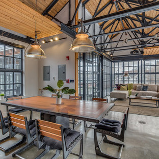 Urban concrete floor great room photo in Boston with white walls