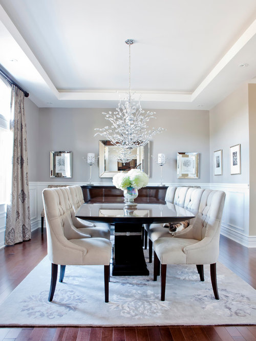 Example of a transitional brown floor dining room design in Montreal with  gray walls