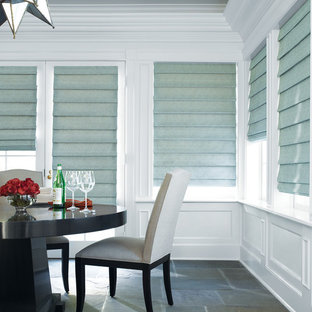 Photo of a transitional dining room in Other.