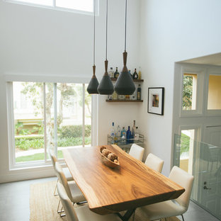 Example of a small trendy dining room design in Orange County with white walls and no fireplace