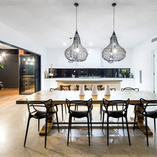 Design ideas for a contemporary kitchen/dining combo in Adelaide with white walls, concrete floors and grey floor.