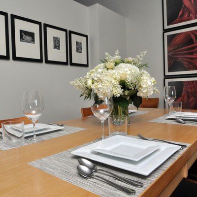 Dining room - contemporary dining room idea in Chicago with gray walls