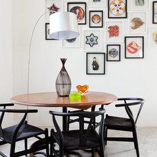 Mediterranean Dining Room by Godrich Interiors