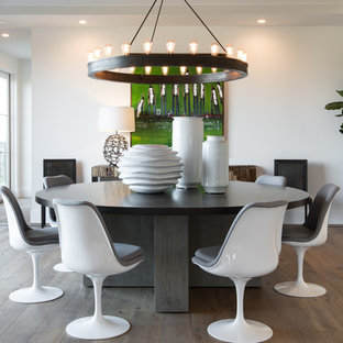 Inspiration for a mid-sized contemporary medium tone wood floor and brown floor enclosed dining room remodel in Orange County with white walls and no fireplace