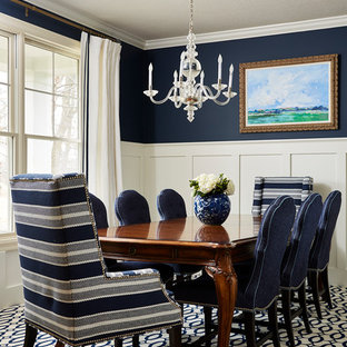This is an example of a mid-sized traditional separate dining room in Minneapolis with blue walls, carpet and multi-coloured floor.