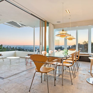 Inspiration for a large contemporary travertine floor and beige floor great room remodel in Los Angeles with beige walls and no fireplace