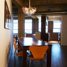 industrial dining room by C O N T E N T Architecture