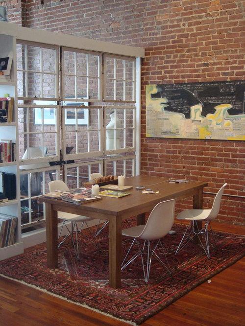 Inspiration For An Industrial Dark Wood Floor Dining Room Remodel In Atlanta