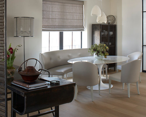 Inspiration For An Industrial Dining Room Remodel In New York With White  Walls