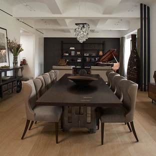 Example of an urban medium tone wood floor dining room design in New York with white walls