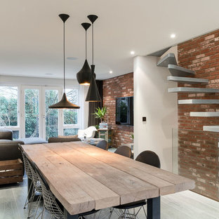 Urban dining room photo in Sussex with white walls
