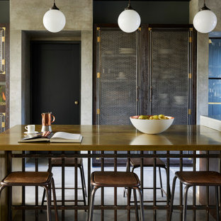 Inspiration for an industrial kitchen/dining room in Cheshire with grey walls and grey floors.