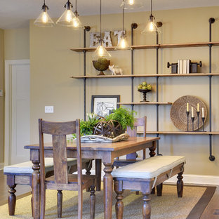 Example of a mid-sized urban dark wood floor and brown floor kitchen/dining room combo design in Minneapolis with beige walls, a standard fireplace and a stone fireplace