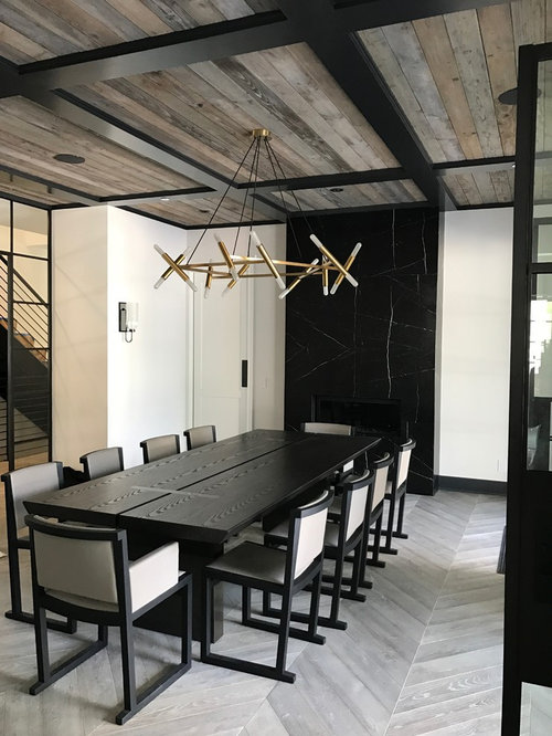 Inspiration For An Industrial Enclosed Dining Room Remodel In Los Angeles With White Walls A