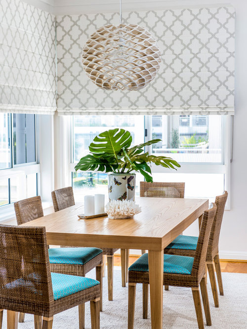 Inspiration For A Beach Style Medium Tone Wood Floor Dining Room Remodel In Brisbane With White