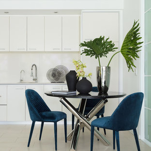 This is an example of a contemporary dining room in Sydney.