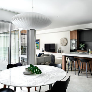 Inspiration for a contemporary open plan dining in Sydney with white walls and grey floor.
