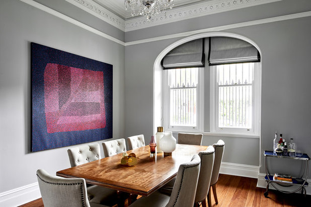 Transitional Dining Room by schemes & spaces