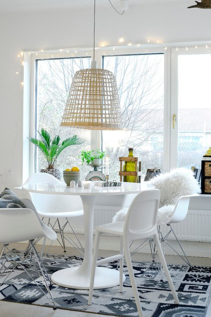Eclectic Dining Room by Monteliushome