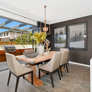 This is an example of a contemporary kitchen/dining combo in Melbourne with brown walls.