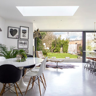 Design ideas for a medium sized contemporary kitchen/dining room in London with white walls, concrete flooring and grey floors.
