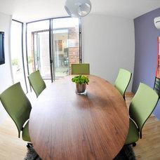 Contemporary Dining Room by Sett Studio