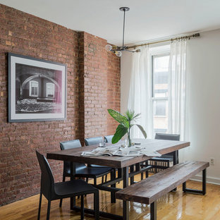 Inspiration for a mid-sized industrial medium tone wood floor kitchen/dining room combo remodel in New York with white walls