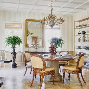 Photo of a mediterranean dining room in Santa Barbara with beige walls, light hardwood floors, no fireplace and beige floor.