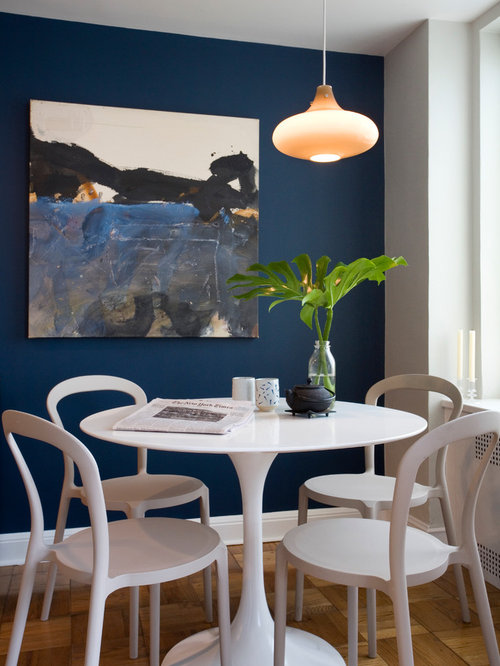 Contemporary Dining Room Idea In Tampa With Blue Walls And Medium Tone Wood Floors