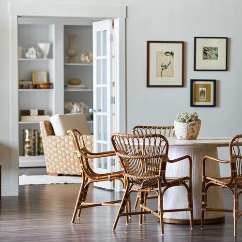 Example Of A Transitional Brown Floor Dining Room Design In San Francisco With White Walls