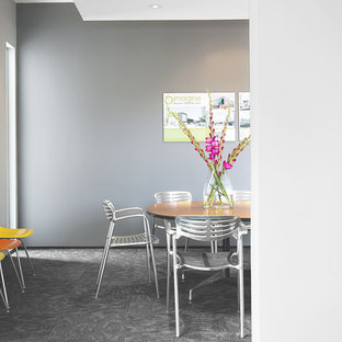 Inspiration for a modern carpeted dining room remodel in Houston with gray walls