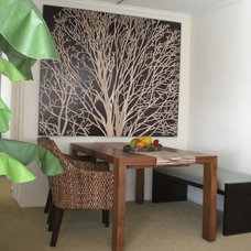 Tropical Dining Room by Square One Interiors