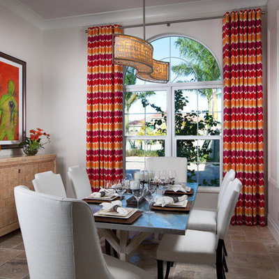 Inspiration for a contemporary dining room remodel in Miami with white walls