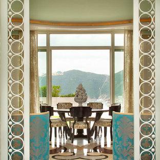Foto de comedor ecléctico, extra grande, cerrado, con paredes verdes y suelo de mármol