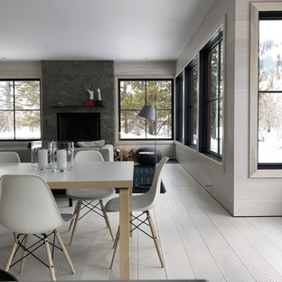 Great room - large scandinavian light wood floor and gray floor great room idea in New York with gray walls, a standard fireplace and a stone fireplace