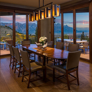 Large mountain style dark wood floor and brown floor kitchen/dining room combo photo in Other with beige walls and no fireplace